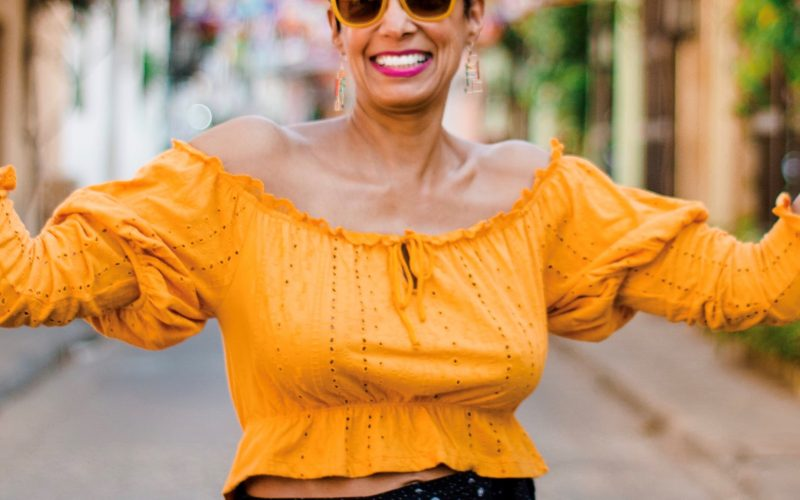 Picture of a black woman in a gold top